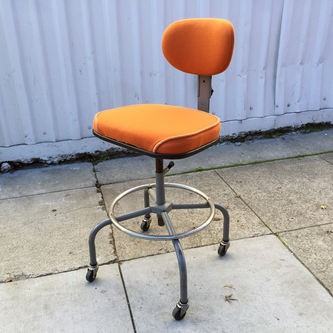 Newly upholstered orange industrial stool at midcenturysanjose