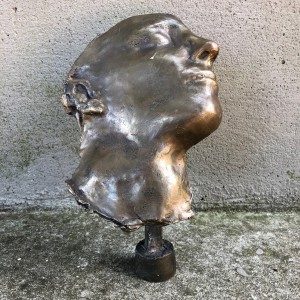 Bronze face sculpture